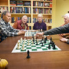 BRYAN EATON/Staff photo. Rick Noonan, right, makes a move in one of two chess matches taking place at the Newburyport Senior Center. They meet on Fridays at 1:00 p.m. and are hoping to get more players to attend. From left, Joe Hull; Ray Mesiti; Walter Soule, who helped organize the games; Nancy Frenette; Charles Smith and Noonan.