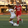 JIM VAIKNORAS/photo Amesbury's Avery Hallinan fights for the ball against St Mary's Schuyler Kiley at Manning Field in Lynn Thursday. Amesbury won the game 1-0.