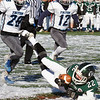 BRYAN EATON/Staff photo. Triton defenders rush to cover Pentucket's Dylan O'Rourke as he hits the snowy turf.