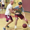BRYAN EATON/Staff photo. Newburyort boys go for basketball tryouts at the Nock Middle School gym on Tuesday night.