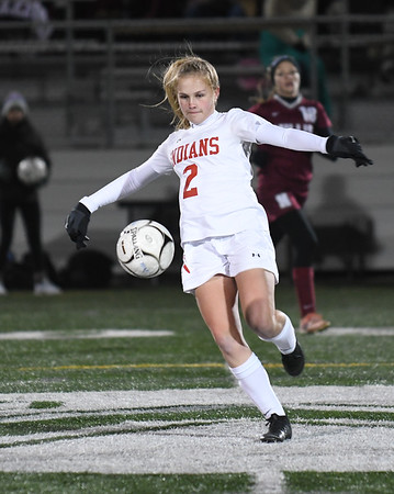 JIM VAIKNORAS/photo Amesbury's Madelyn Creps clears the ball against Millis during their state semi-final game at Mansfield High School Wednesday. Amesbury lost the game 2-1.