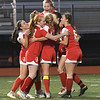 JIM VAIKNORAS/photo Amesbury celebrates Gracie Doherty's goal against St Mary's at Manning Field in Lynn Thursday. Amesbury won the game 1-0.