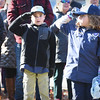 "BRYAN EATON/Staff photo. Cub Scouts and Weblos salute as they join in the ""Pledge of Allegiance"" at Amesbury's services."