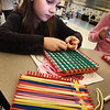 BRYAN EATON/Staff photo. Sawyer Wilson, 8, and others make potholders at the YWCA Afterschool program to be given to ladies at the Y's residences as a gift for Thanksgiving. Last year they made placements for the tenants.