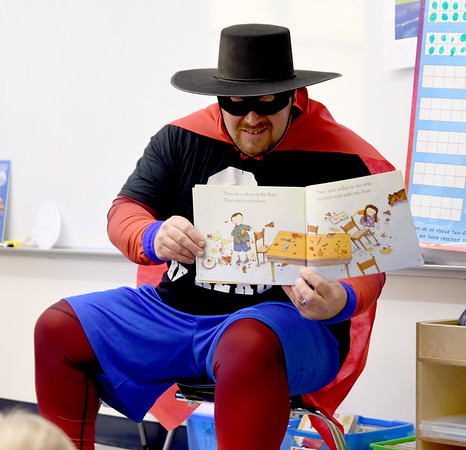 JIM VAIKNORAS/photo Zero the Hero, AKA Ken Perseghian of the Newburyport Fire Dept. visits Melissa Duguie's kindergarten class at the Bresnahan School in Newburyport Thursday. Zero was at the school to celebrate the school years 50th day.