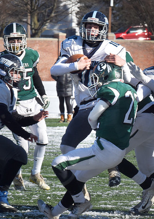 BRYAN EATON/Staff photo. Triton's Cameron Gilroy gets stopped by Pentucket defense.