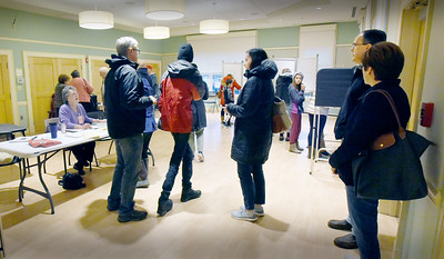 BRYAN EATON/Staff photo. Despite the rain outside, voting was steady during the lunch hour at the polling places at Newburyport's Senior Center on Tuesday.