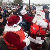 JIM VAIKNORAS/photo Santa and Mrs. Claus wave to the crowd after arriving on the Newburyport Waterfront  Sunday afternoon for the city's annual parade and tree lighting.