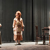 "BRYAN EATON/Staff photo. Cast members of the production of ""Anne of Green Gables"" at Newburyort's Nock Middle School in rehearsal, from left, Emma Foley as ""Rachel Lynde,"" Rachel Conover, one of four ""Annes"" in the play, and Kajsa Woodger as ""Marilla Cuthbert."""