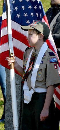 JIM VAIKNORAS/photo Christian Brow, 10, of scout pack 21 holds the flag Veterans Cemetery Monday at the annual Newburyport Veterans Day Ceremony.
