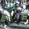 BRYAN EATON/Staff photo. Triton defenders move in on Pentucket's Dylan O'Rourke.