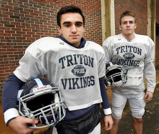 BRYAN EATON/Staff photo. Triton's Jack Tummino, left, with Ethan Tremblay.