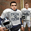 BRYAN EATON/Staff photo. Triton's Jack Tummino, left, with Ethan Tremblay.