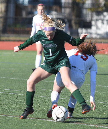 JIM VAIKNORAS/photo Amesbury's Maia Esty collides with Mancester-Essex player Maya Baker during their game at Manning Field in Lynn Sunday. Amesbury won the game 2-1 in double overtime.