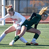 JIM VAIKNORAS/photo Amesbury's Meghan McElaney get tangles with Mancester-Essex playerMia Cromwell during their game at Manning Field in Lynn Sunday. Amesbury won the game 2-1 in double overtime.