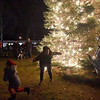 BRYAN EATON/Staff photo. Youngsters pose for photos in front the Salisbury Christmas Tree that was lit in the town common on Sunday night. The Salisbury Elementary School Band performed and Santa Claus arrived on a Salisbury Fire Department fire engine handing out candy to the children. After the lighting, which was sponsored by the Salisbury Chamber of Commerce and the Salisbury Historical Society with refreshments provided by the East Parish United Methodist Church and the Institution For Savings.