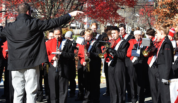BRYAN EATON/Staff photo. The Amesbury High School marching band performs a medley of songs from branches of the U. S. military.