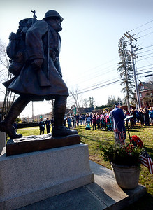 BRYAN EATON/Staff photo. Master of ceremonies Gary Eichenlaub, commander of American Legion Post 187, speaks to those gathered in the shadow of the Doughboy Statue at Amesbury Veterans Day services.