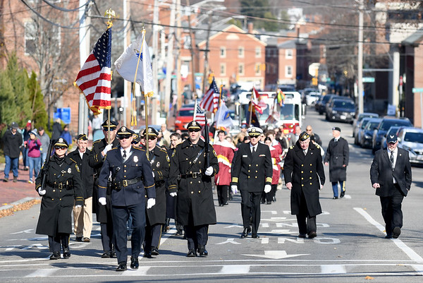 JIM VAIKNORAS/photo Participants in the annual Newburyport Veterans Day ceremony make their way up State Street from City Hall to Veterans Cemetery Monday morning.