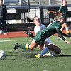 JIM VAIKNORAS/photo Amesbury's Emma DiPietro collides with Mancester-Essex player Jade Cromwell during their game at Manning Field in Lynn Sunday. Amesbury won the game 2-1 in double overtime.