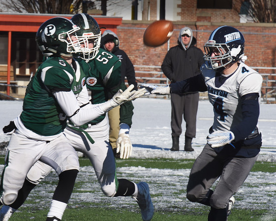 BRYAN EATON/Staff photo. Pentucket's Jake Etter waits for the catch as Triton's Charles Takesian moves in.