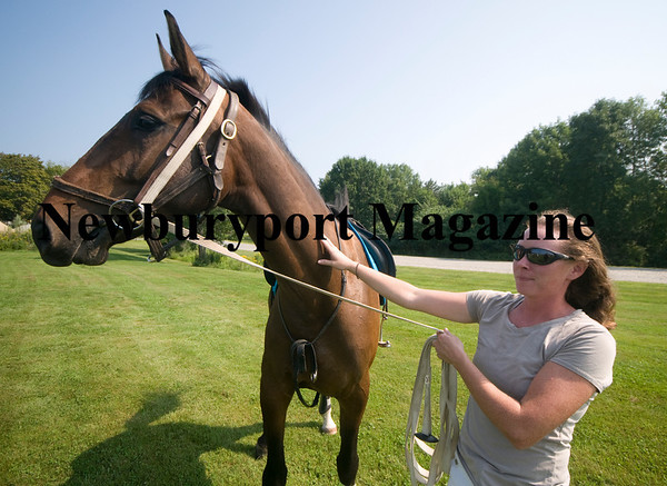 West Newbury: Amanda McNally excersices Abe at Pipe Stave Hill. Jim  Vaiknoras/Staff photo