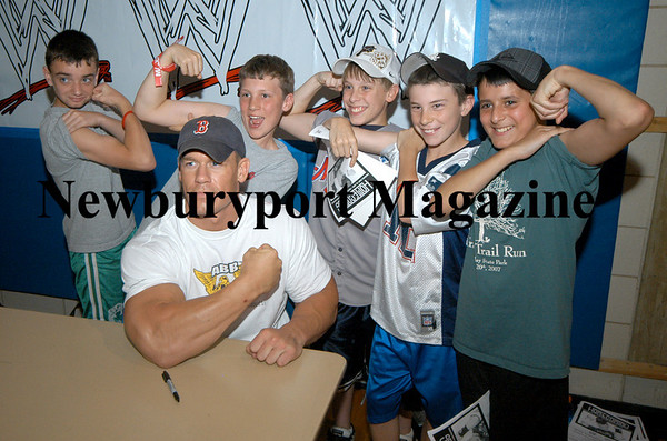 Byfield:  Wrestler John Cena and a group of boys from Salisbury Little League show off there guns before a match at Triton Friday night. <br /> Photo by Jim Vaiknoras/Newburyport Daily News. Saturday, May 26, 2007