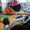 Will Acquaviva, 4, gets comfortable as library Beth Sceery reads in the Children's Room of the Emma Andrews Branch Library. Photo by Bryan Eaton