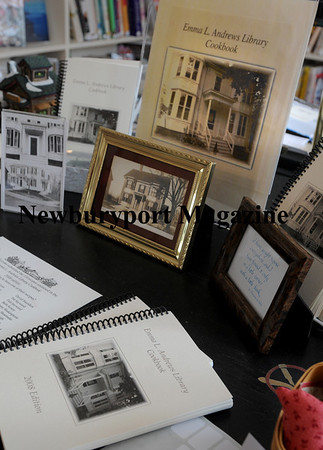 Emma L. Andrews Cookbook on sale among a display of old photos of the Newburyport branch library. Photo by Bryan Eaton