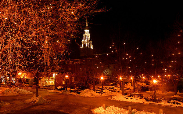 "Newburyport: <br /> "" Sleep in heavenly peace, sleep in heavenly peace""""<br /> <br /> The steeple of the Unitarian Church stands above Inn Street bright with holiday lighting on a quiet calm evening.<br /> Photo by Jim Vaiknoras/Newburyport Daily News. Sunday, December 18, 2005"