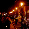 Newburyport: <br /> A few evening shoppers make their way up a brightly lite Inn Street Sunday night .<br /> Photo by Jim Vaiknoras/Newburyport Daily News. Sunday, December 19, 2004