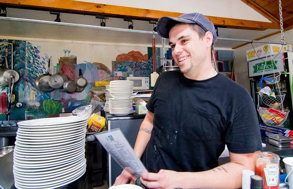 Newbury: Owner of Mad Martha's, Brad Delibro, discusses his favorite menu items with a customer. Photo by Ben Laing/Staff Photo