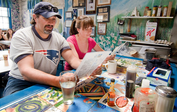 Newbury: Chris Gerace and Rebecca Roosevelt peruse the menu at Mad Martha's on Plum Island. Photo by Ben Laing/Staff Photo