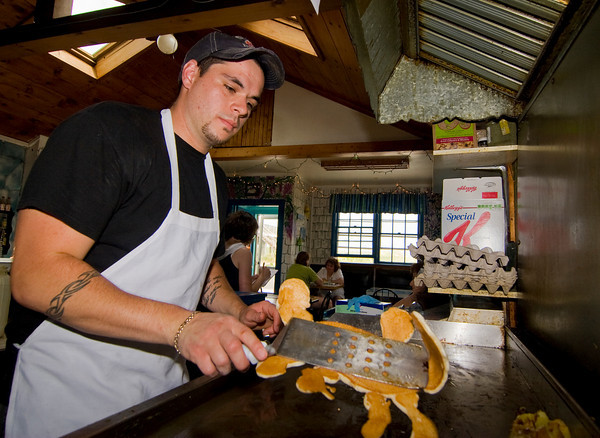 "Newbury: Owner of Mad Martha's, Brad Delibro, flips one of their ""character"" pancakes, in this case a crab. Children are encourage to order their favorite character or shapes, and are even challenged to stump the chef. Photo by Ben Laing/Staff Photo"