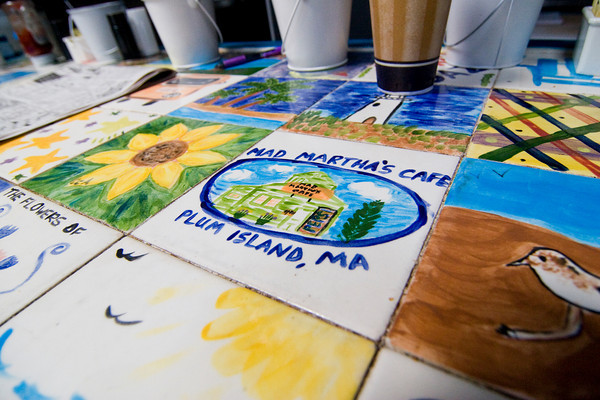 Newbury: A breakfast counter adorned with hand painted tiles by friends and family is the centerpiece of Mad Martha's on Plum Island. Photo by Ben Laing/Staff Photo