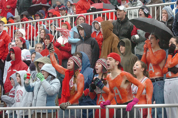 Amesbury: <br /> Amesbury High football fans, some wearing grease paint for shirts, cheer on their team against Newburyport yesterday. Their efforts paid off as their team won the historic rivalry by 20-0.<br /> Photo by Bryan Eaton/Newburyport Daily News. Wednesday, November 22, 2006