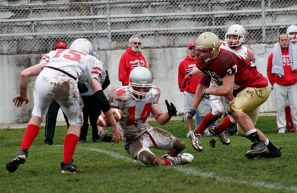 Newburyport: Amesbury's Jake Conant (14) fumbles the ball after getting hit by Newburyport's Derek Freeman (37) as the Clippers hosted their rivals in the annual Thanksgiving Day football game. Newburyport shut out the Indians 33-0. Photo by Ben Laing/Staff Photo<br /> , Newburyport: Amesbury's Jake Conant (14) fumbles the ball after getting hit by Newburyport's Derek Freeman (37) as the Clippers hosted their rivals in the annual Thanksgiving Day football game. Newburyport shut out the Indians 33-0. Photo by Ben Laing/Staff Photo