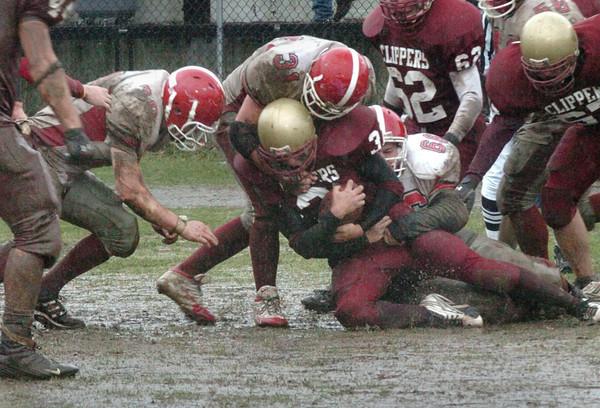 Newburyport: <br /> Amesbury defenders take down Newburyport's Sam Melanson during yesterday's Thanksgiving Day game.<br /> Photo by Bryan Eaton/Newburyport Daily News. Thursday, November 24, 2005