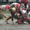 Newburyport: <br /> Amesbury defenders take down Newburyport's Sam Melanson during yesterday's Thanksgiving Day game.<br /> Photo by Bryan Eaton/Newburyport Daily News. Thursday, November 24, 2005