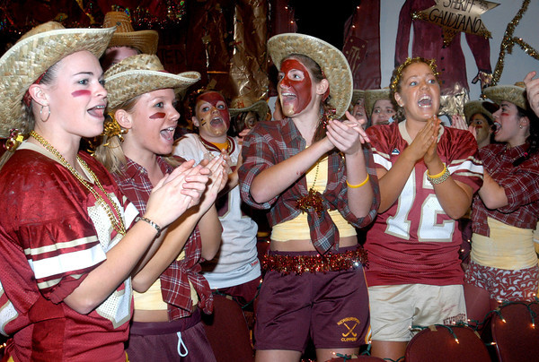Newburyport: <br /> Newburyport High fans cheer as the football team enters the auditorium during Color Day yesterday. The tradition gets students excited about today's Thanksgiving Day game against longtime rival Amesbury High.<br /> Photo by Bryan Eaton/Newburyport Daily News. Wednesday, November 24, 2004
