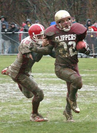 Newburyport: <br /> Amesbury's E.J. Flanagan  moves in on Clipper's Joe Pace yesterday in Newburyport.<br /> Photo by Bryan Eaton/Newburyport Daily News. Thursday, November 24, 2005