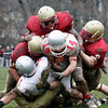 Newburyport: A quartet of Clippers bring down Amesbury running back Jake Conant (14) as Newburyport hosted their rivals in their annual Thanksgiving Day football game. Newburyport shut out the Indians 33-0. Photo by Ben Laing/Staff Photo<br /> , Newburyport: A quartet of Clippers bring down Amesbury running back Jake Conant (14) as Newburyport hosted their rivals in their annual Thanksgiving Day football game. Newburyport shut out the Indians 33-0. Photo by Ben Laing/Staff Photo