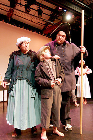 Newburyport: Penny Lazarus, left, Katherine Hall, center, and Michael Pirollo, right, star in the Firehouse's upcoming production of  Oliver. Photo by Ben Laing/Staff Photo