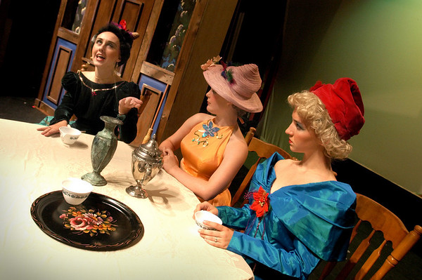 """Newburyport: <br /> Jen MacLean """"Stepmother"""" tells her daughters Rachel McBride """"Portia"""" and Allie Hadwen """"Joy"""" about courting men in the Firehouse Center production of Cinderella.<br /> Photo by Bryan Eaton/Newburyport Daily News. Tuesday, July 27, 2004"""