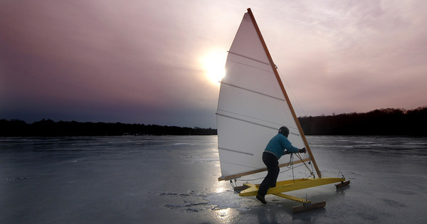 Newburyport: Peter Kirk of Salisbury gives his ice boat a push to get it going as he glides across the Artichoke Saturday afternoon. The cold weather after the thaw last week created a nice smooth surface conducive to ice boats. Jim Vaiknoras/Staff photo<br /> , Newburyport: Peter Kirk of Salisbury gives his ice boat a push to get it going as he glides across the Artichoke Saturday afternoon. The cold weather after the thaw last week created a nice smooth surface conducive to ice boats. Jim Vaiknoras/Staff photo