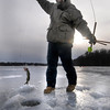Newburyport: Jacob Eaton, 15, of Salisbury pull a pickerel out of  the Artickoke in Newburyport while ice fishing Saturday. After removing the hook, Eaton returned the fish, hopefully a bit wiser to the water. Jim Vaiknoras/Staff photo