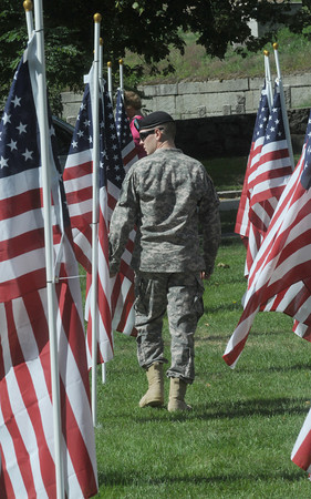 Newburyport: Serviceman Matt Gibson walks amoung the Field of Honor at the Bartlet Mall Saturday after a ceremony marking the 9th anniversary of the September 11 attacks. Jim Vaiknoras/Staff photo<br /> , Newburyport: Serviceman Matt Gibson walks amoung the Field of Honor at the Bartlet Mall Saturday after a ceremony marking the 9th anniversary of the September 11 attacks. Jim Vaiknoras/Staff photo