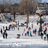 Newburyport: Skaters move about on the frozen Frog Pond at the Winter Carnival on the Mall in Newburyport Saturday. Hundreds enjoyed a day of skating , sledding, hockey and fun. Jim  Vaiknoras/Staff photo<br /> , Newburyport: Skaters move about on the frozen Frog Pond at the Winter Carnival on the Mall in Newburyport Saturday. Hundreds enjoyed a day of skating , sledding, hockey and fun. Jim  Vaiknoras/Staff photo