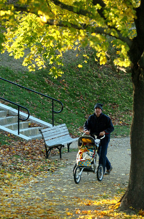 Newburyport:Morgan Stebbins walks his son Colby ,3 , along the Frog Pond at the Bartlet Mall. The pair had been feeding the duck and enjoying the cool fall day.<br /> Photo by Jim Vaiknoras/Newburyport Daily News Sunday, November 11, 2007