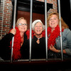 Liz Portalla, Anne Dodge and Paula Quill are behind bars at the Roaring 20<br /> party at the Firehouse